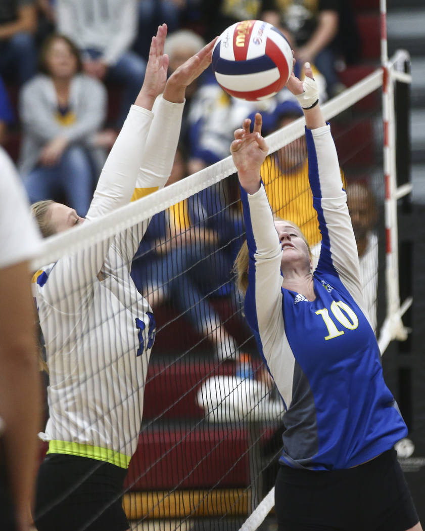 Lowry's Brittany Jacaway (12) blocks a shot from Moapa Valley's Aria Messer (10) during the Class 3A state volleyball game at Faith Lutheran High School in Las Vegas on Friday, Nov. 10, 2017. Chas ...