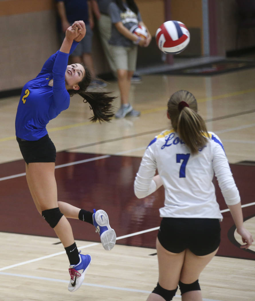 Lowry's Kepa Bengochea (2) sends a shot over to Moapa Valley during the Class 3A state volleyball game at Faith Lutheran High School in Las Vegas on Friday, Nov. 10, 2017. Chase Stevens Las Vegas  ...