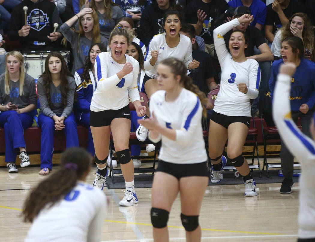 Lowry players celebrate while playing Moapa Valley during the Class 3A state volleyball game at Faith Lutheran High School in Las Vegas on Friday, Nov. 10, 2017. Chase Stevens Las Vegas Review-Jou ...