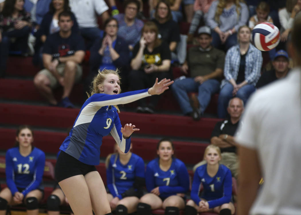 Moapa Valley's Eden Whitmore (9) sends the ball to Lowry during the Class 3A state volleyball game at Faith Lutheran High School in Las Vegas on Friday, Nov. 10, 2017. Chase Stevens Las Vegas Revi ...