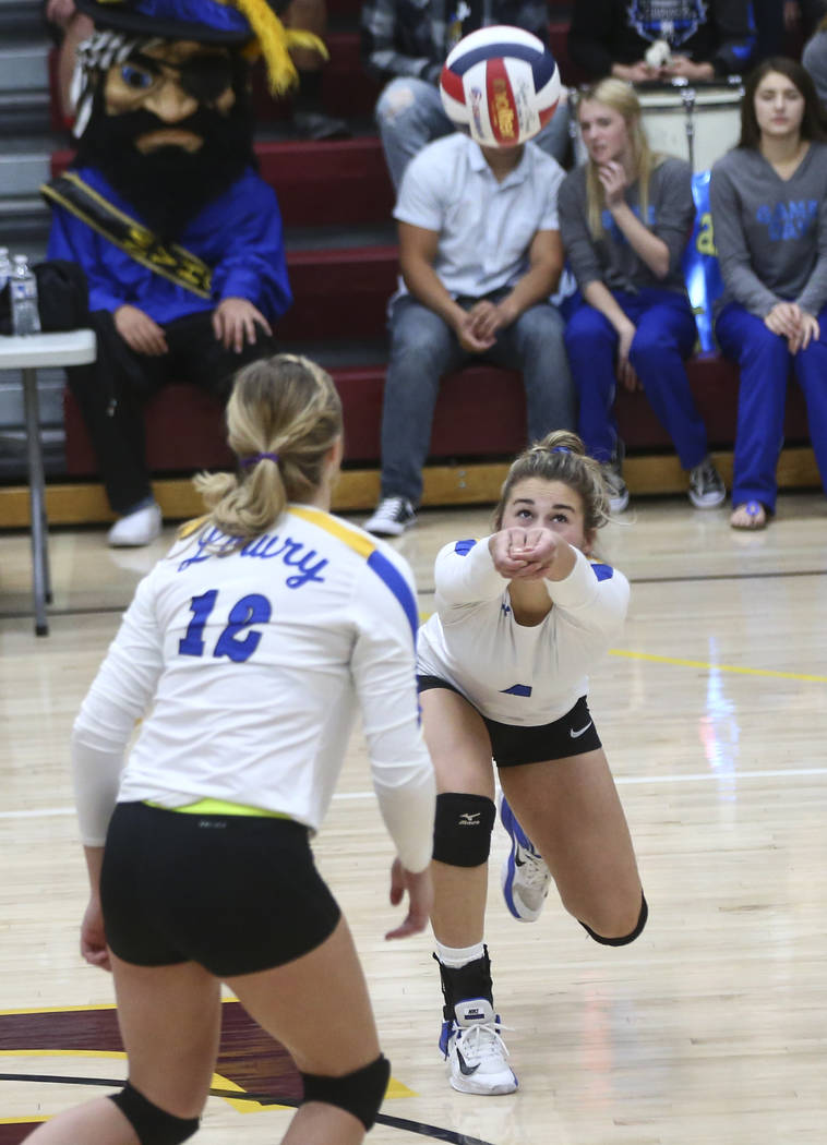 Lowry's Julianne Montero (4) goes for the ball while playing Moapa Valley during the Class 3A state volleyball game at Faith Lutheran High School in Las Vegas on Friday, Nov. 10, 2017. Chase Steve ...