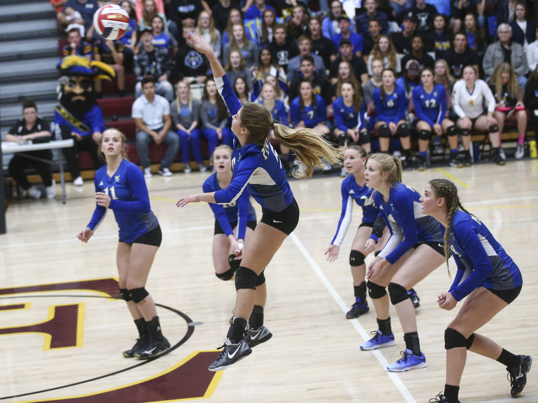 Moapa Valley's Dannika Gordon (5) sends the ball over to Lowry during the Class 3A state volleyball game at Faith Lutheran High School in Las Vegas on Friday, Nov. 10, 2017. Chase Stevens Las Vega ...