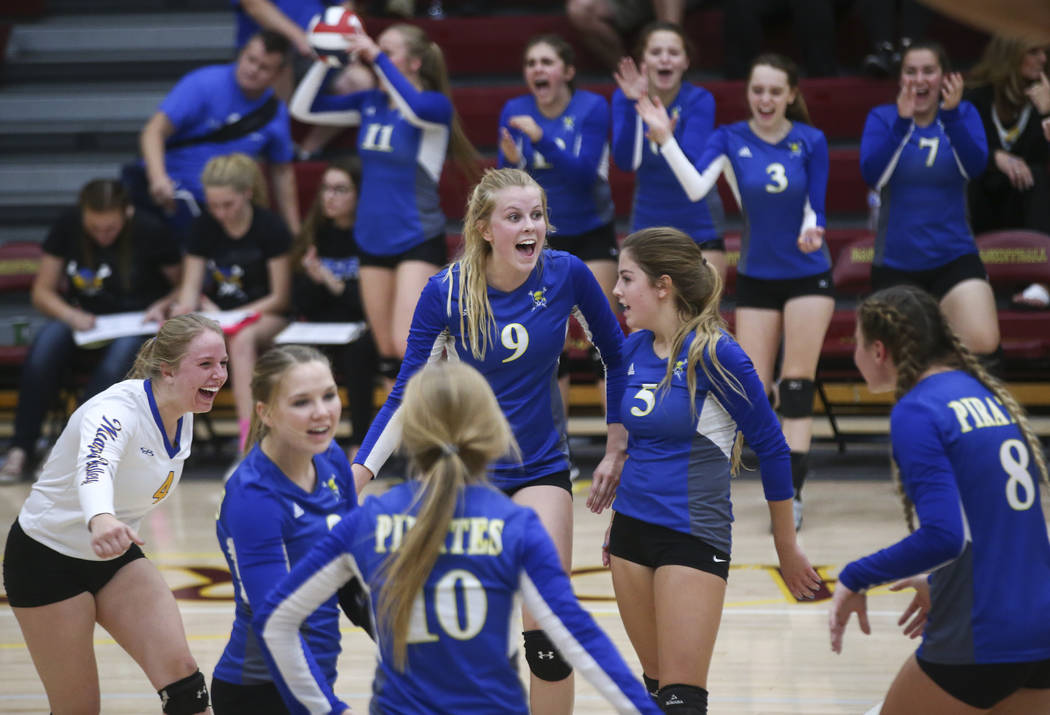 Moapa Valley players celebrate while playing Lowry  during the Class 3A state volleyball game at Faith Lutheran High School in Las Vegas on Friday, Nov. 10, 2017. Chase Stevens Las Vegas Review-Jo ...