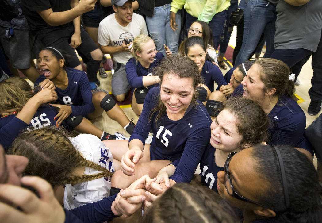 Shadow Ridge senior Whittnee Nihipali (15) celebrates with her teammates after defeating the Gorman Gaels in the Class 4A state volleyball championship game at Faith Lutheran High School in Las Ve ...