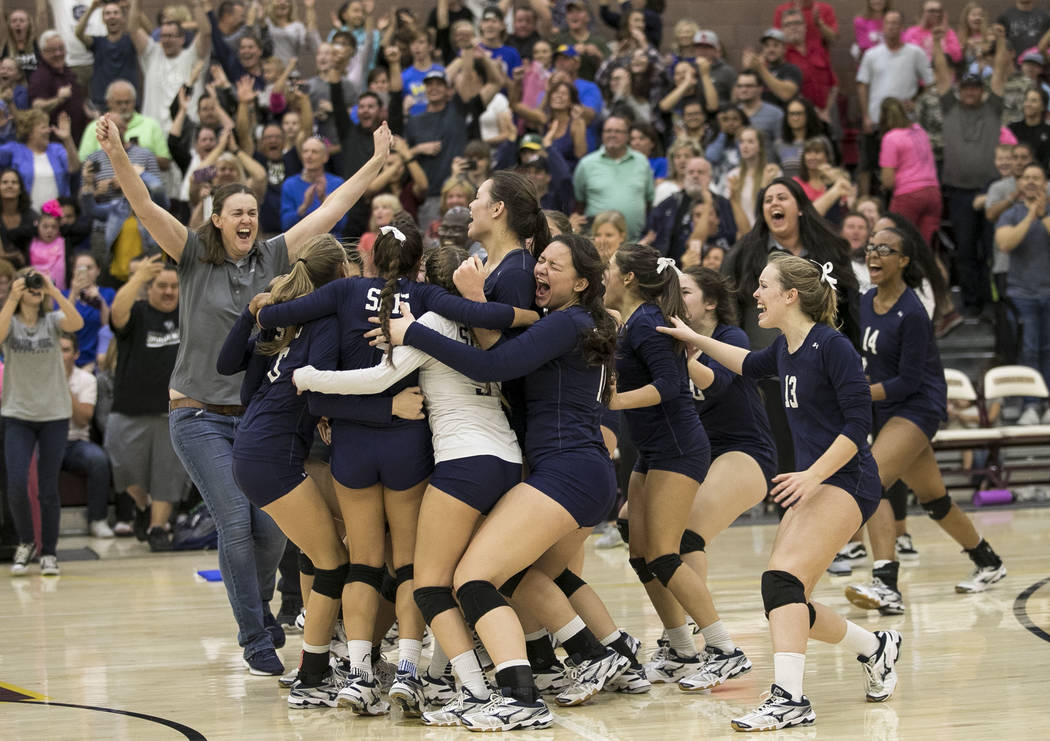 Shadow Ridge celebrates after defeating the Gorman Gaels in the Class 4A state volleyball championship game at Faith Lutheran High School in Las Vegas on Saturday, Nov. 11, 2017. Richard Brian Las ...