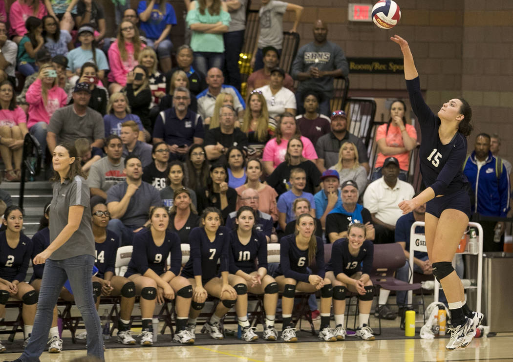 Shadow Ridge senior Whittnee Nihipali (15) serves the ball against the Gorman Gaels in the Class 4A state volleyball championship game at Faith Lutheran High School in Las Vegas on Saturday, Nov.  ...