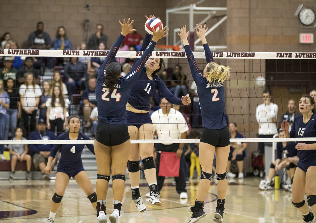 Shadow Ridge's Kahea Nihipali (11) spikes against Gorman's Alex Washington (24) and Lilly Hoff (2) during the Class 4A state volleyball championship game at Faith Lutheran High School in Las Vegas ...