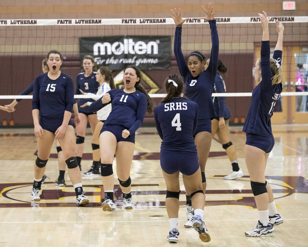 Shadow Ridge's Kahea Nihipali (11) and teammates celebrate after Nihipali blocked the ball against Gorman during the Class 4A state volleyball championship game at Faith Lutheran High School in La ...