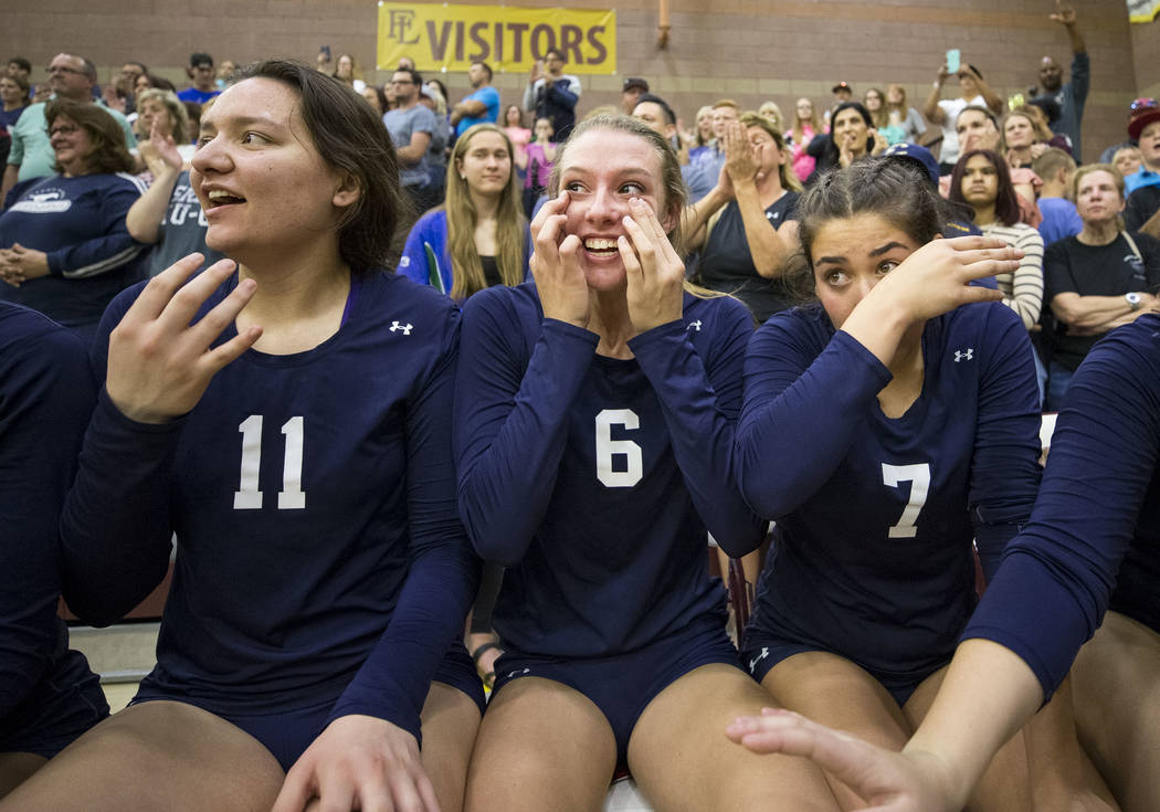 Shadow Ridge's Madyson Lousignont (6) and Meghan Hoadley (7) react with tears of joy after defeating the Gorman Gaels in the Class 4A state volleyball championship game at Faith Lutheran High Scho ...