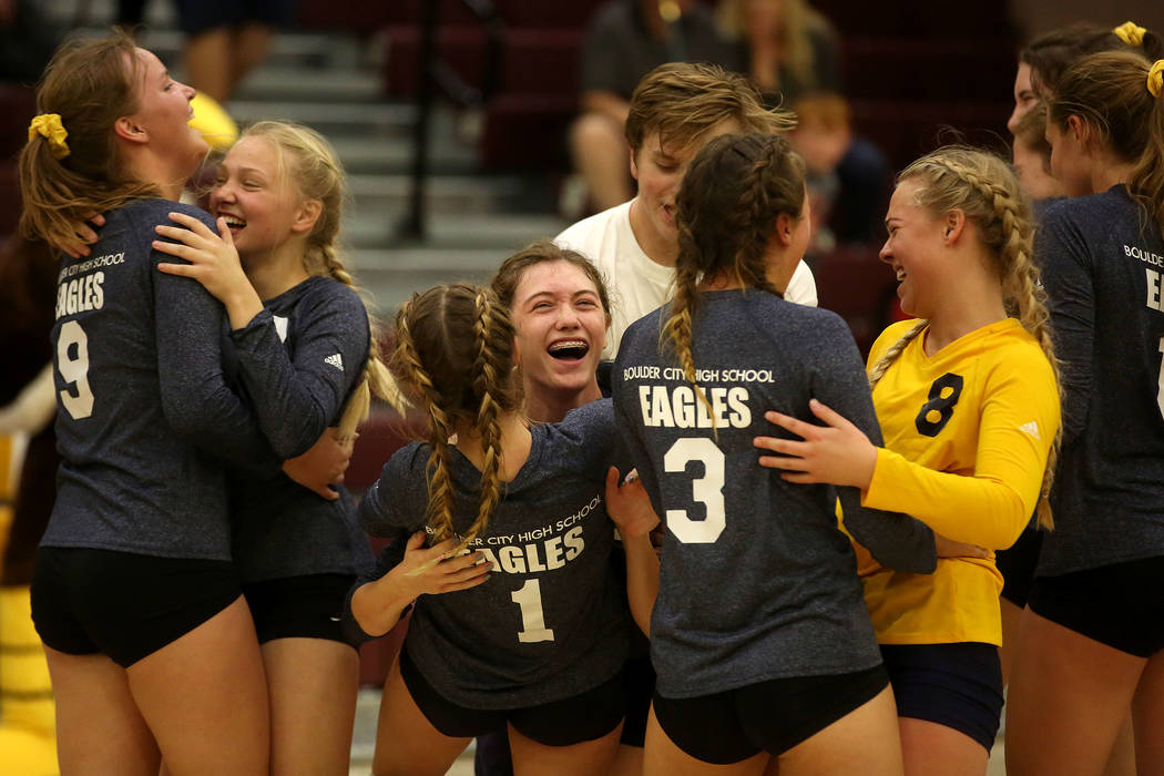 Boulder City teammates celebrate their 3-2 win over Moapa Valley during the class 3A state volleyball championship at Faith Lutheran in Las Vegas on Saturday, Nov. 11, 2017. Bridget Bennett Las Ve ...