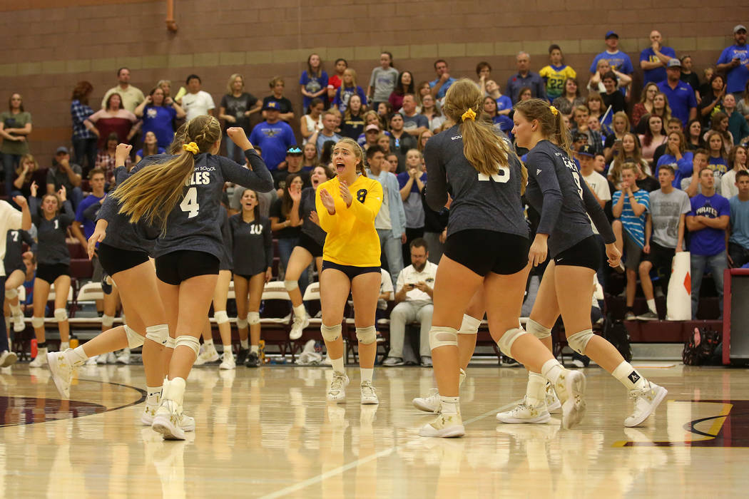 Boulder City teammates celebrate a point over Moapa Valley during the class 3A state volleyball championship at Faith Lutheran in Las Vegas on Saturday, Nov. 11, 2017. Boulder City won 3-2. Bridge ...