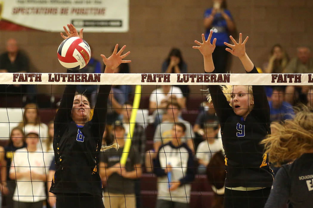 Moapa Valley teammates Shelbi Walker (8) and Eden Whitmore (9) attempt to block Boulder Cityճ ball during the class 3A state volleyball championship at Faith Lutheran in Las Vegas on Saturda ...