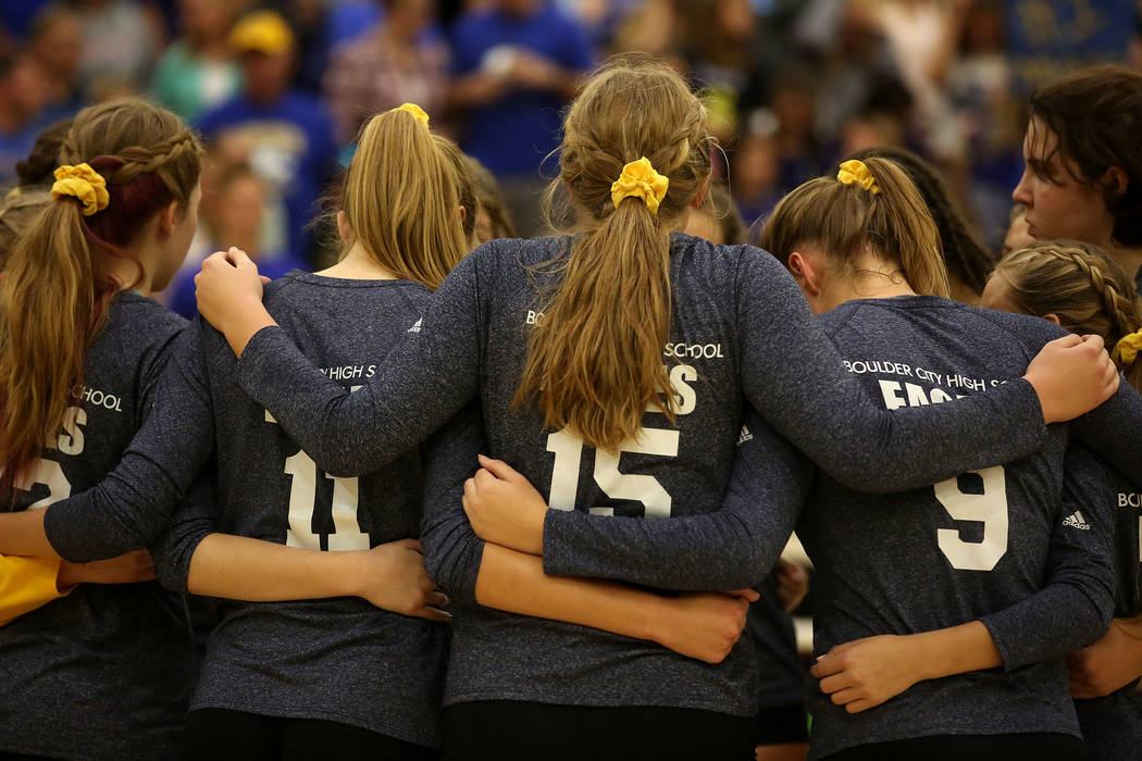 Boulder City teammates huddle between sets during the class 3A state volleyball championship at Faith Lutheran in Las Vegas on Saturday, Nov. 11, 2017. Boulder City won 3-2. Bridget Bennett Las Ve ...