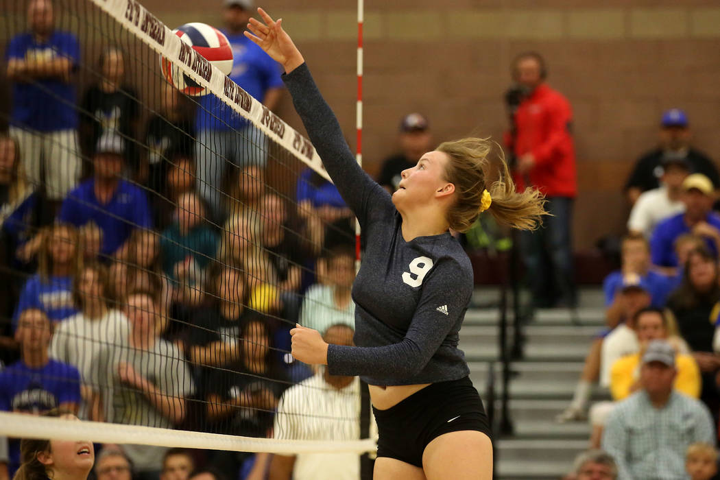 Boulder City player Jerra Hinson hits the ball  over the net during the class 3A state volleyball championship game against Moapa Valley at Faith Lutheran in Las Vegas on Saturday, Nov. 11, 2017.  ...