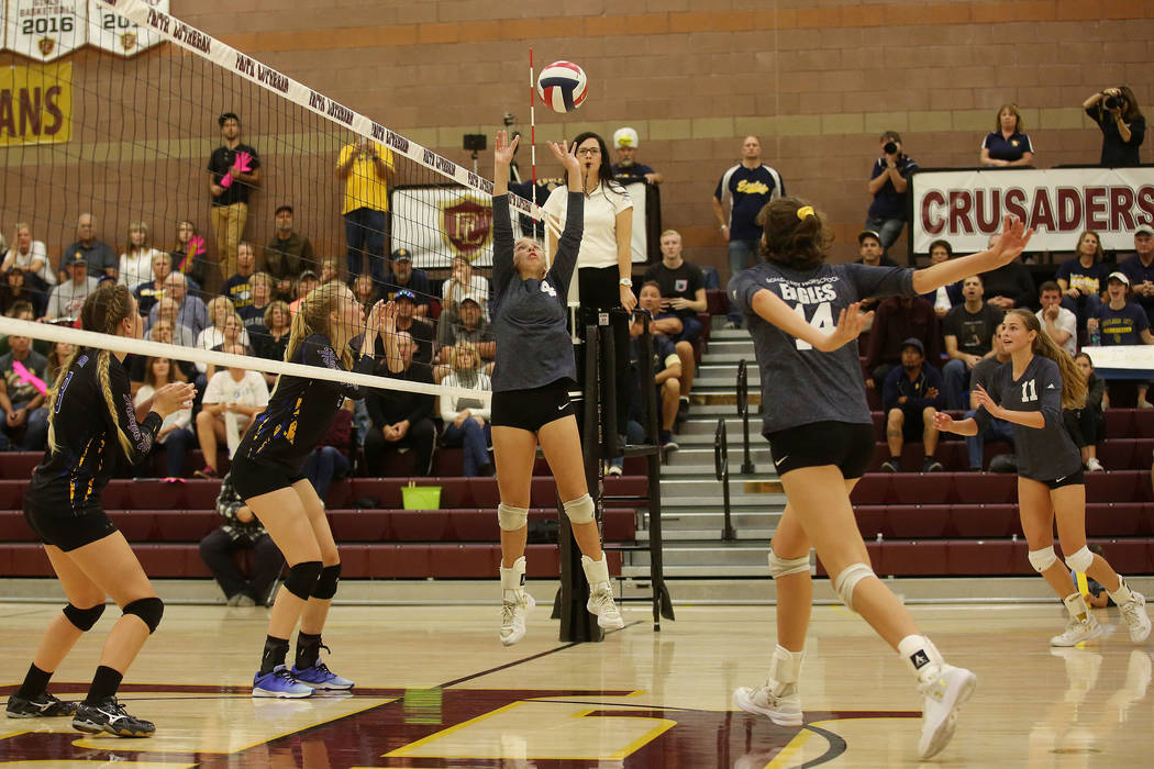 Boulder City player Ava Wright sets the ball during the class 3A state volleyball championship game against Moapa Valley at Faith Lutheran in Las Vegas on Saturday, Nov. 11, 2017. Boulder City won ...