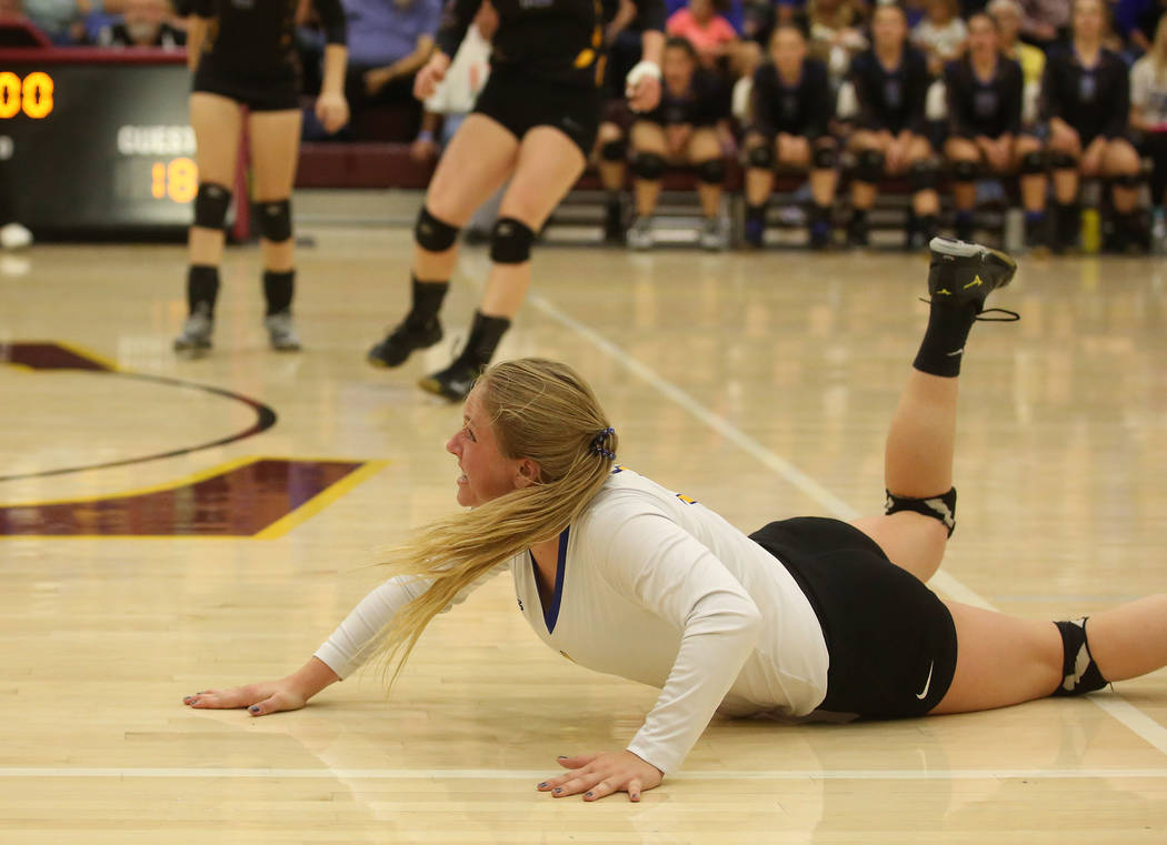 Moapa Valley player Kessa Evans attempts to dive for the ball during the class 3A state volleyball championship game against Boulder City at Faith Lutheran in Las Vegas on Saturday, Nov. 11, 2017. ...