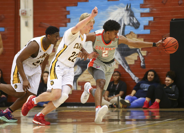 Bishop Gorman's Jamal Bey (2) and Clark's Trey Woodbury (22) are two of the top returning boys basketball players this season. (Chase Stevens/Las Vegas Review-Journal) @csstevensphoto