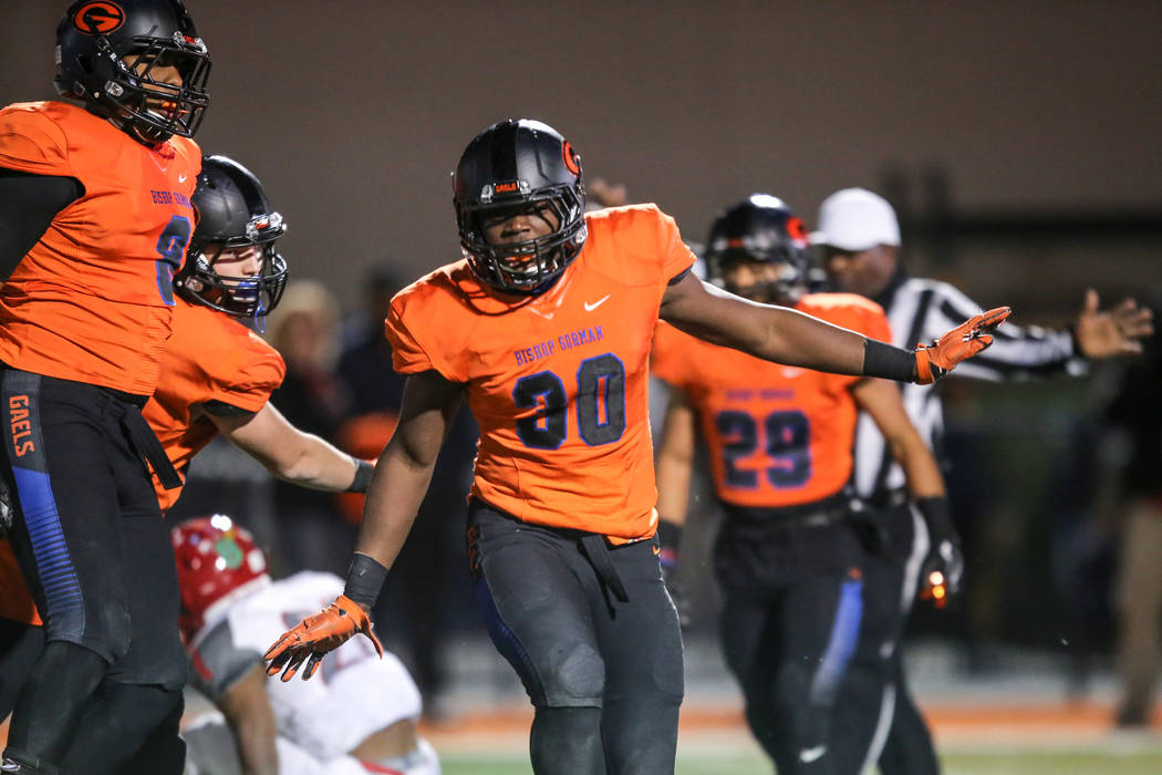 Bishop Gorman's Jeffrey Ulofoshio (30) celebrates after making a tackle against Arbor View during the second quarter of the Class 4A Sunset Region Title football game at Bishop Gorman High School  ...