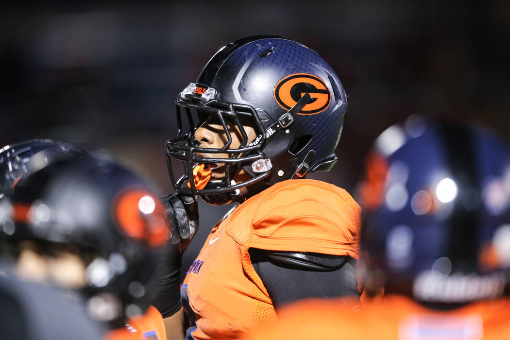 Bishop Gorman's Adam Plant (8) gathers in a huddle during the third quarter of the Class 4A Sunset Region Title football game against Arbor View at Bishop Gorman High School in Las Vegas, Friday,  ...