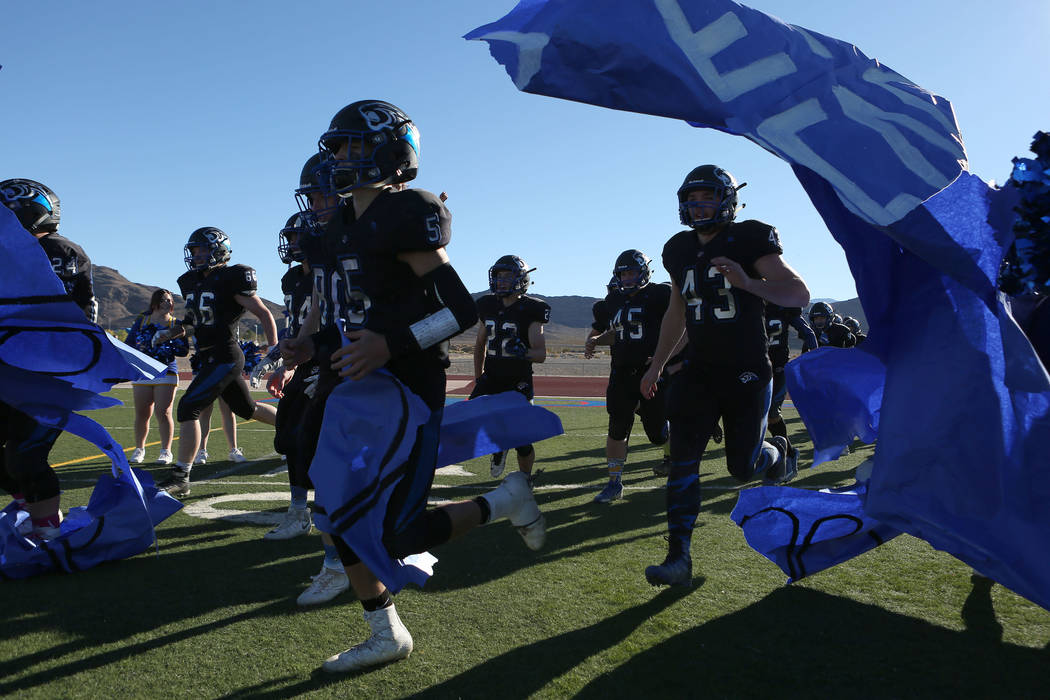 Pahranagat Valley players run on to the field for the class A state championship game against Spring Mountain at Indian Springs High School in Indian Springs, Saturday, Nov. 18, 2017. Pahranagat V ...