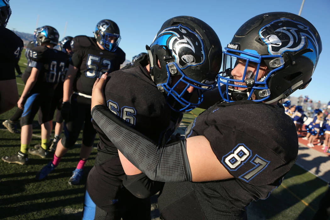 Pahranagat Valley players Tyler Bundy (66) and Ryan Jorgensen (87) embrace after the class A state championship game against Spring Mountain at Indian Springs High School in Indian Springs, Saturd ...