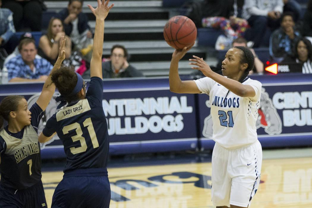 Centennial's Justice Ethridge (21) takes a shot against Spring Valley in the girls basketball game at Centennial High School on Friday, Dec. 9, 2016, in Las Vegas. Centennial won 64-20. Erik Verdu ...