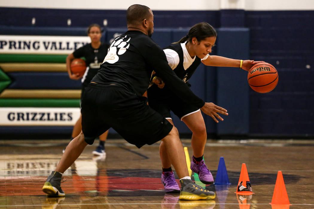 Assistant coach Errol Campbell, left, guards Essence Booker (3), right, during a basketball practice at Spring Valley High School in Las Vegas, Thursday, Nov. 16, 2017. Joel Angel Juarez Las Vegas ...