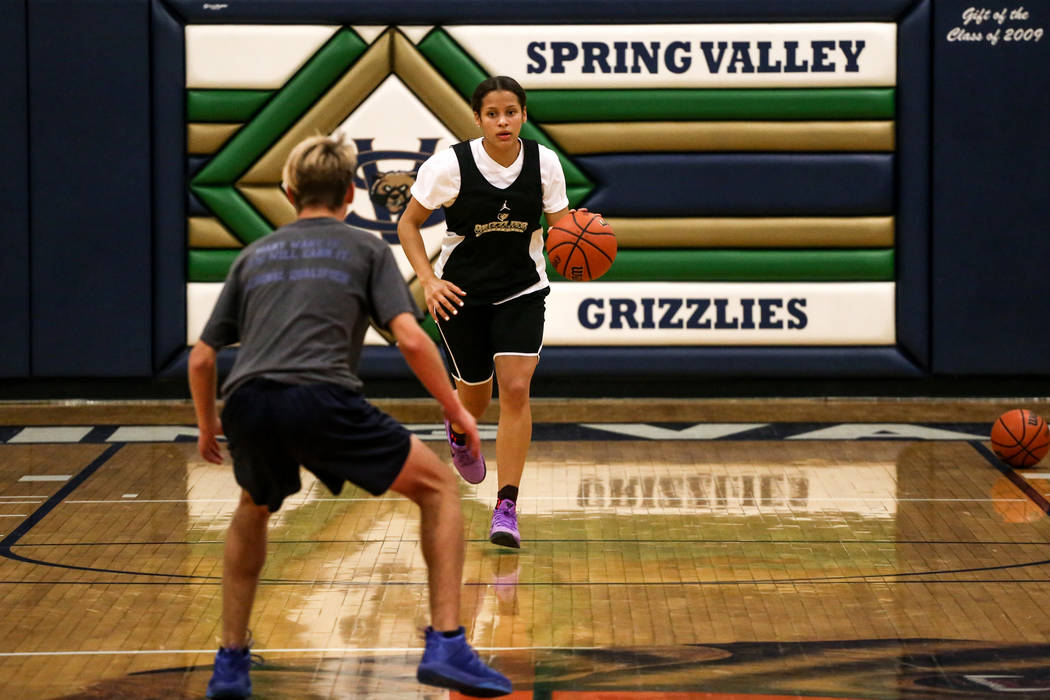 Essence Booker (3) dribbles the ball as she is guarded by a teammate during a basketball practice at Spring Valley High School in Las Vegas, Thursday, Nov. 16, 2017. Joel Angel Juarez Las Vegas Re ...