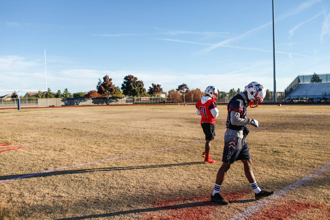 Liberty Patriots' Allan Mwata, right, walks on the field during a football practice at Liberty High School in Henderson, Thursday, Nov. 23, 2017. Joel Angel Juarez Las Vegas Review-Journal @jajuar ...
