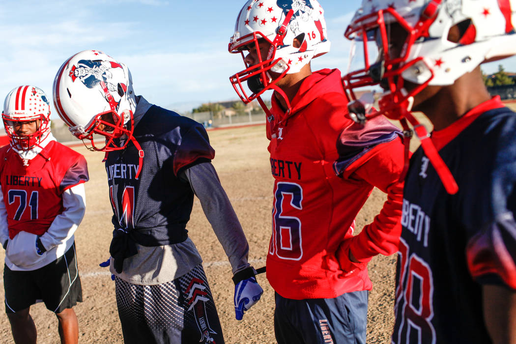 Liberty Patriots' Allan Mwata, second from left, gathers in a huddle with teammates during a football practice at Liberty High School in Henderson, Thursday, Nov. 23, 2017. Joel Angel Juarez Las V ...