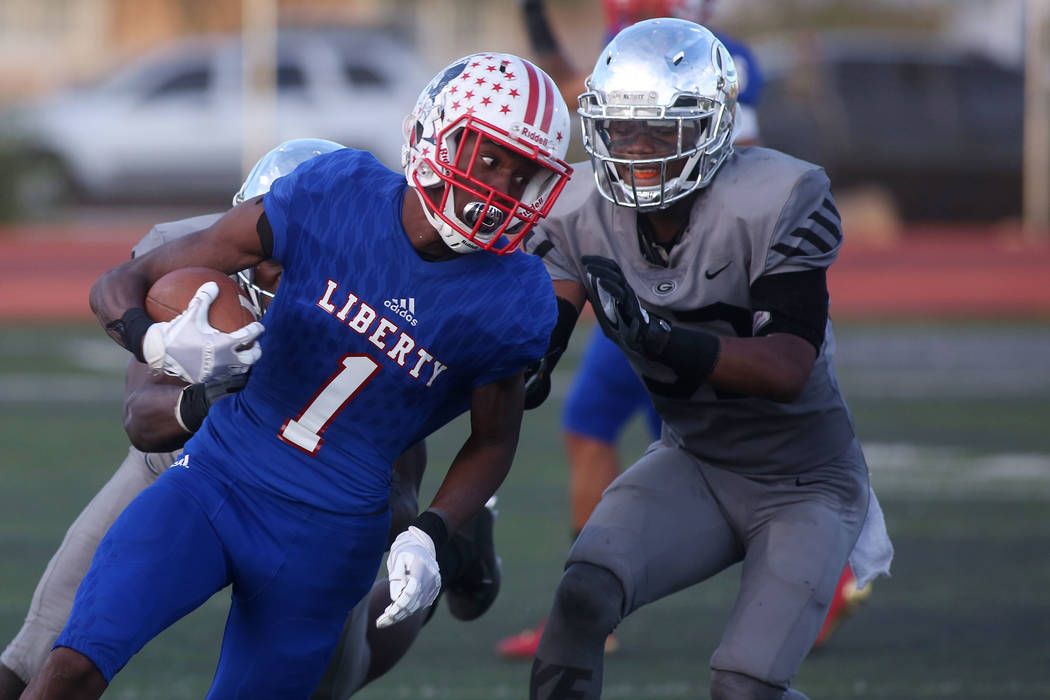 Liberty player Marquez Powell (1) runs the ball during the class 4A state semifinal football game against Bishop Gorman at Rancho High School in Las Vegas, Friday, Nov. 24, 2017. Bishop Gorman won ...