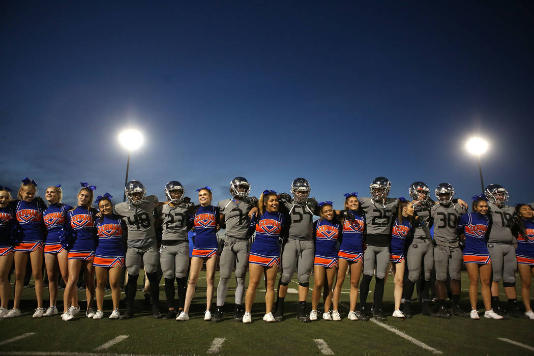 Bishop Gorman players and cheerleaders gather after their class 4A state semifinal football game against Liberty at Rancho High School in Las Vegas, Friday, Nov. 24, 2017. Bishop Gorman won 35-13. ...