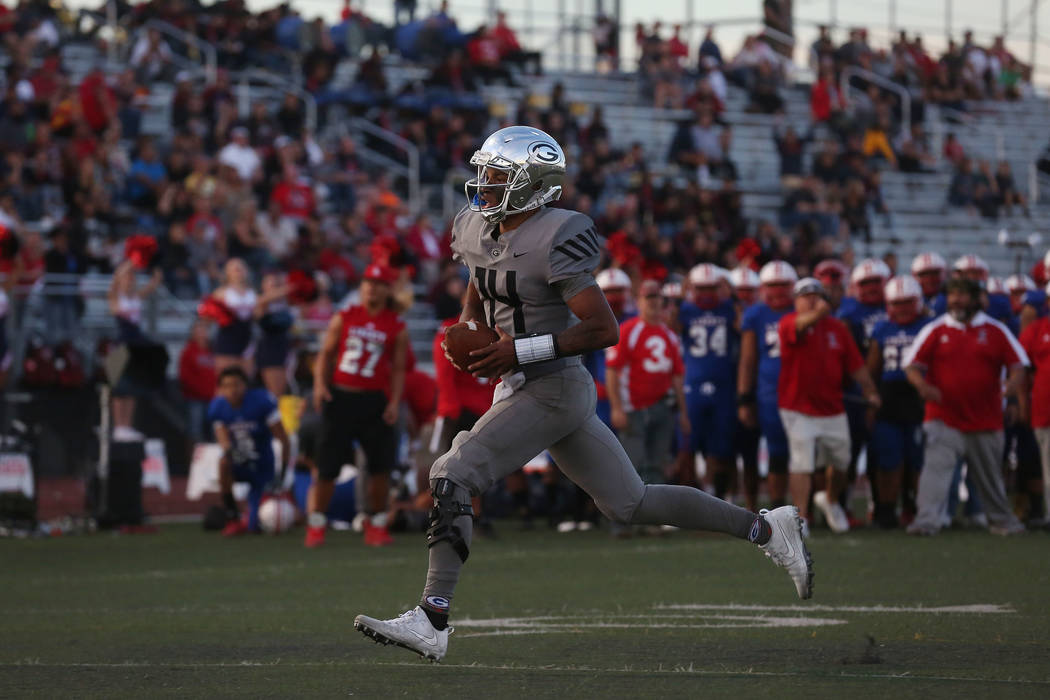Bishop Gorman player Dorian Thompson-Robinson (14) runs the ball during the class 4A state semifinal football game against Liberty at Rancho High School in Las Vegas, Friday, Nov. 24, 2017. Bishop ...