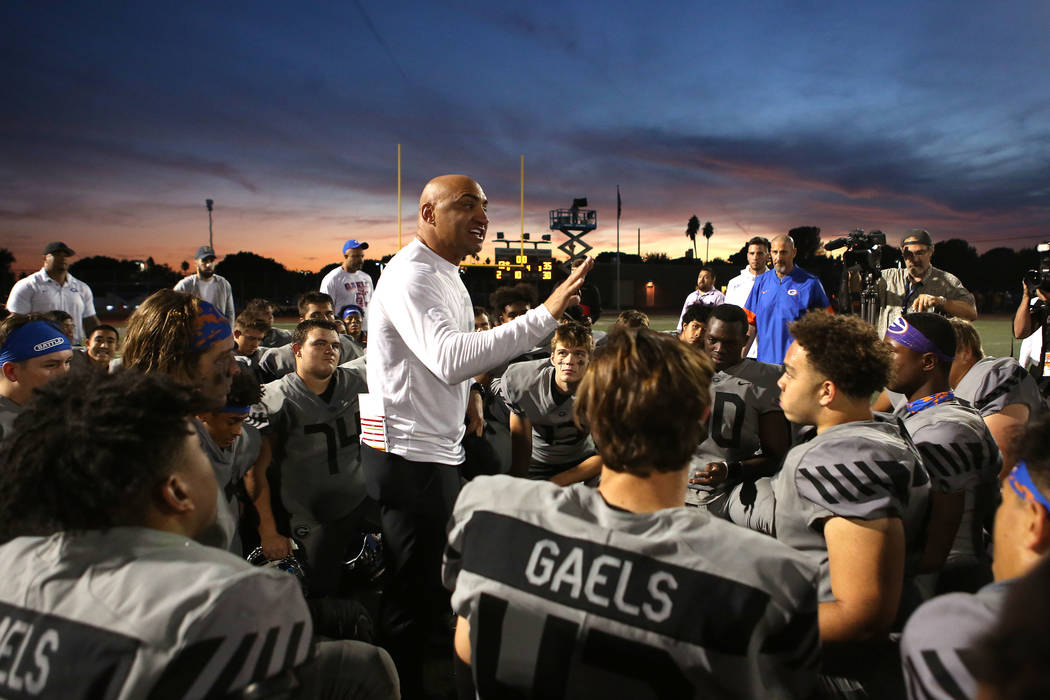 Bishop Gorman head coach Kenny Sanchez talks to the team after their class 4A state semifinal football game against Liberty at Rancho High School in Las Vegas, Friday, Nov. 24, 2017. Bishop Gorman ...