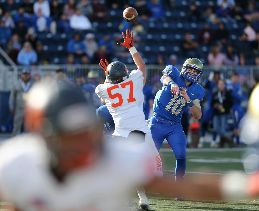 Bishop Gorman's Jaxon Bozarth pressures Reed quarterback Cameron Emerson in the second half of the NIAA 4A state championship football game in Reno, Nev., on Saturday, Dec. 2, 2017. Gorman  ...