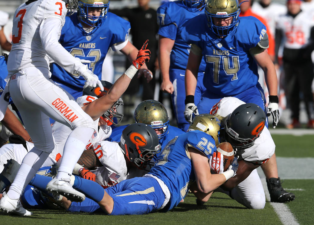 Bishop Gorman and Reed players fight for a loose ball during the first half of the NIAA 4A state championship football game in Reno, Nev., on Saturday, Dec. 2, 2017. Cathleen Allison/Las Vegas Rev ...