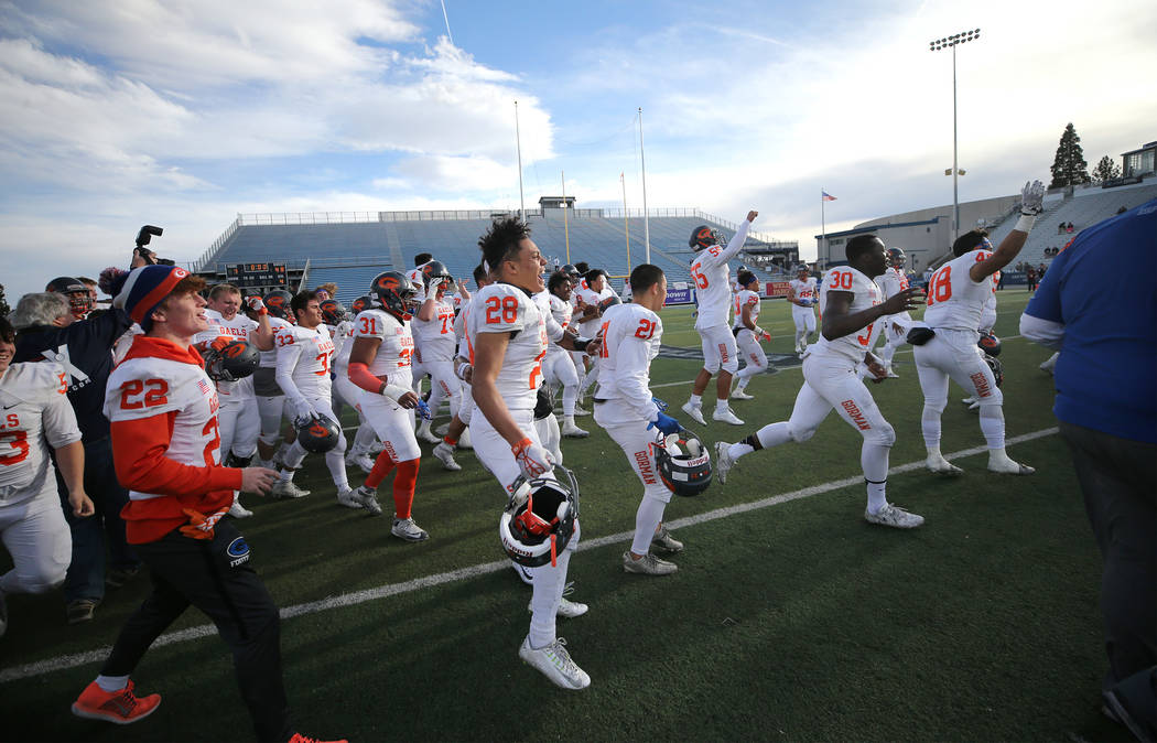 Bishop Gorman celebrates their 48-7 victory over Reed for the NIAA 4A state championship in Reno, Nev., on Saturday, Dec. 2, 2017. Cathleen Allison/Las Vegas Review Journal @NVMomentum