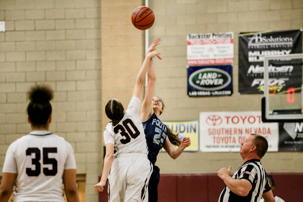 Desert Oasis' Sierra Mich'l (30), left, and Foothill's Taylor Bair (22), right, reach for a jump ball at start of the first quarter of a basketball game at Desert Oasis High School in Las Vegas, M ...