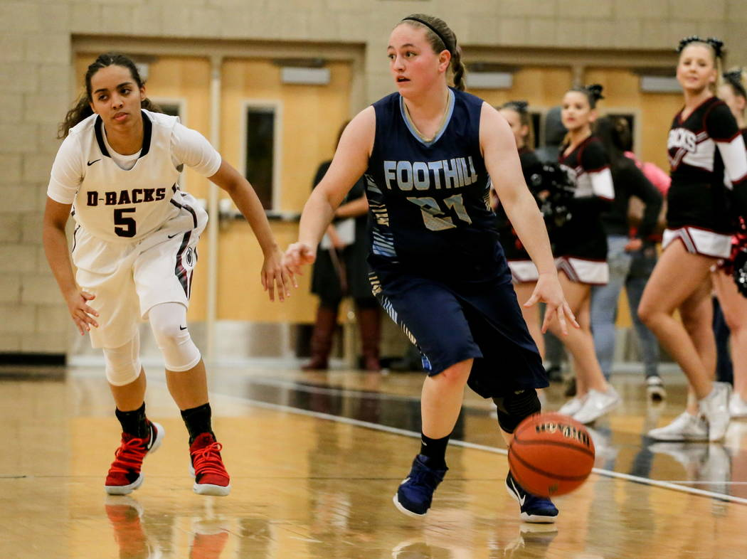 Desert Oasis' Eliyjah Pricebrooks (5), left, chases after Foothill's Rhianna Cox (21), right, during the first quarter of a basketball game at Desert Oasis High School in Las Vegas, Monday, Dec. 4 ...