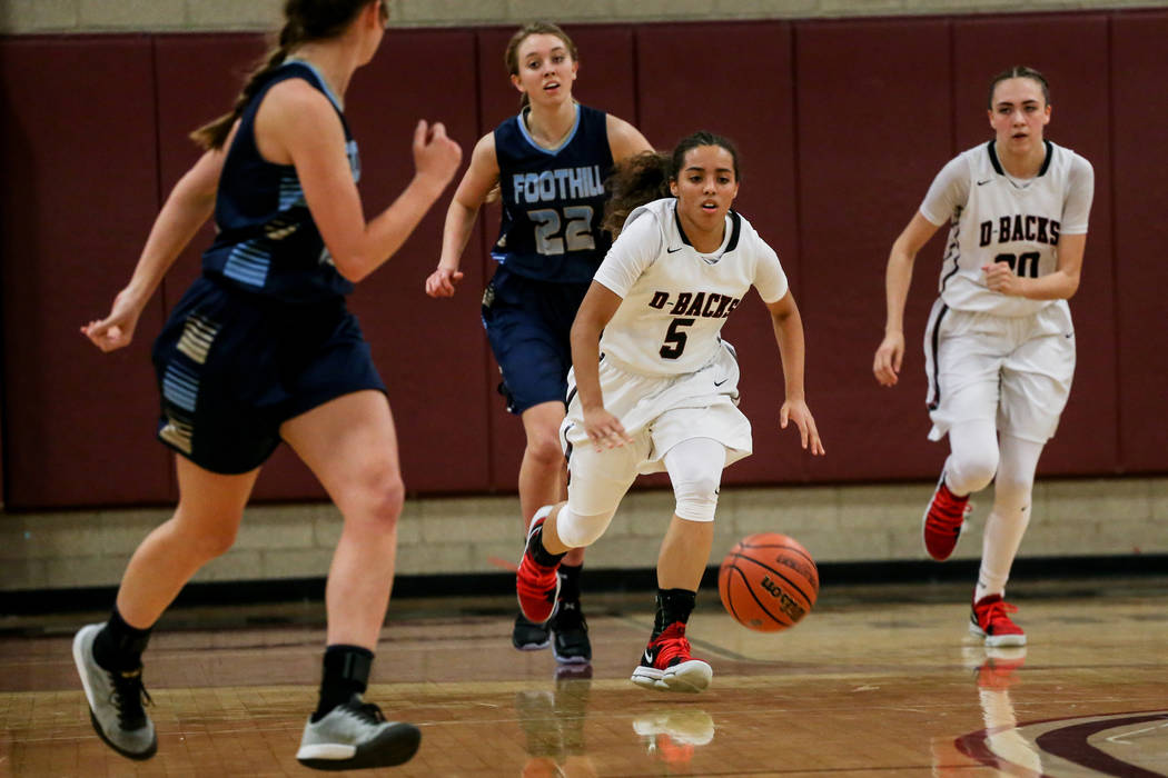 Desert Oasis' Eliyjah Pricebrooks (5), second from right, dribbles the ball down court during the second quarter of a basketball game against Foothill at Desert Oasis High School in Las Vegas, Mon ...