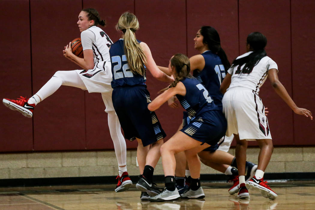 Desert Oasis' Sierra Mich'l (30), left, catches a rebound during the second quarter of a basketball game against Foothill at Desert Oasis High School in Las Vegas, Monday, Dec. 4, 2017. Desert Oas ...