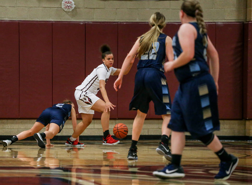 Desert Oasis' Dajaah Lightfoot (35), second from left, dribbles the ball against Foothill during the third quarter of a basketball game at Desert Oasis High School in Las Vegas, Monday, Dec. 4, 20 ...