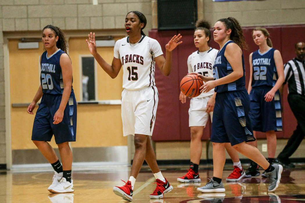 Desert Oasis' Ahmaya Smith (15), second from left, reacts after a foul during the third quarter of a basketball game against Foothill at Desert Oasis High School in Las Vegas, Monday, Dec. 4, 2017 ...