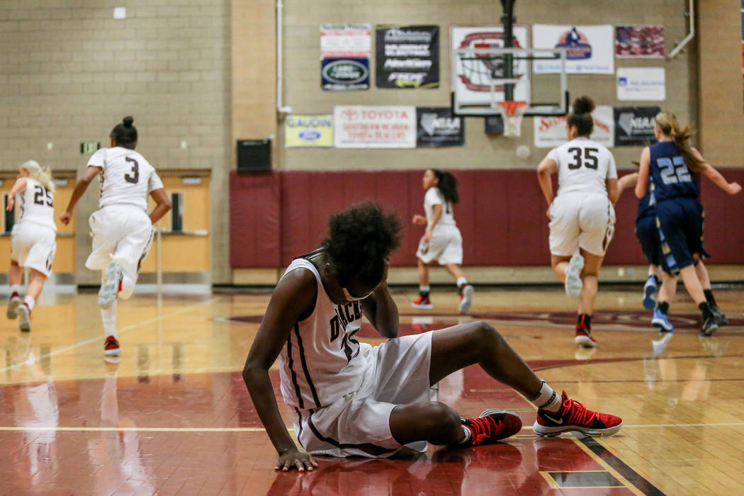 Desert Oasis' Desi-rae Young (23) rubs her head after hitting the ground during the fourth quarter of a basketball game against Foothill at Desert Oasis High School in Las Vegas, Monday, Dec. 4, 2 ...