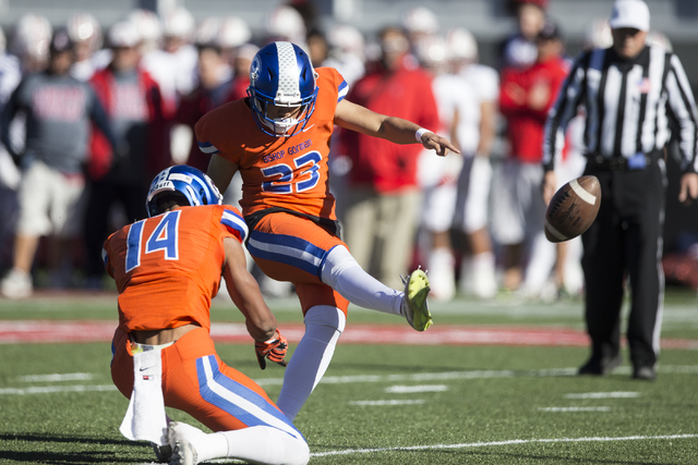 Bishop Gorman's Derek Ng (23) kicks the ball for an extra point against Liberty in the Class 4A state football championship game at Sam Boyd Stadium on Saturday, Dec. 3, 2016, in Las Vegas. Bishop ...