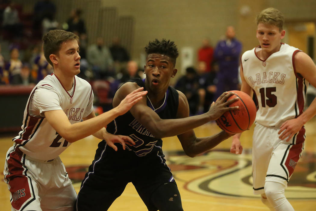 Durango player Vernell Watts (22) looks for a teammate to pass to during a game against Desert Oasis at Desert Oasis High School in Las Vegas, Wednesday, Dec. 6, 2017.   Desert Oasis won 93-77. Br ...
