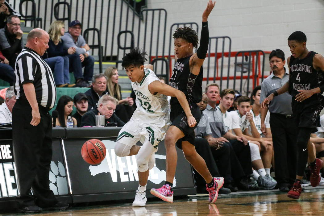 Palo Verde's Dylan Yoro (22), left, and Cimarron-Memorial's Karion Harrell (21), right, chase after the ball during the second quarter of a basketball game at Palo Verde High School  ...