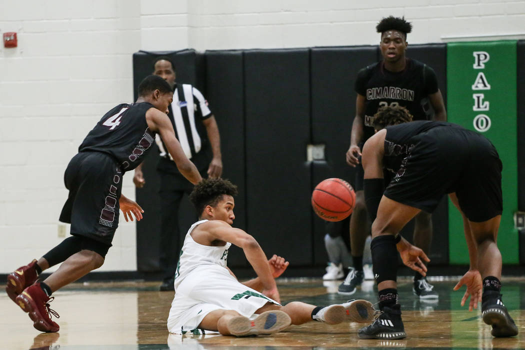 Cimarron-Memorial's Ricky Singleton (4), left, Palo Verde's Donovan Stewart (3), center, and Cimarron-Memorial's Marcus Phillips (0), right, chase after the ball during the se ...