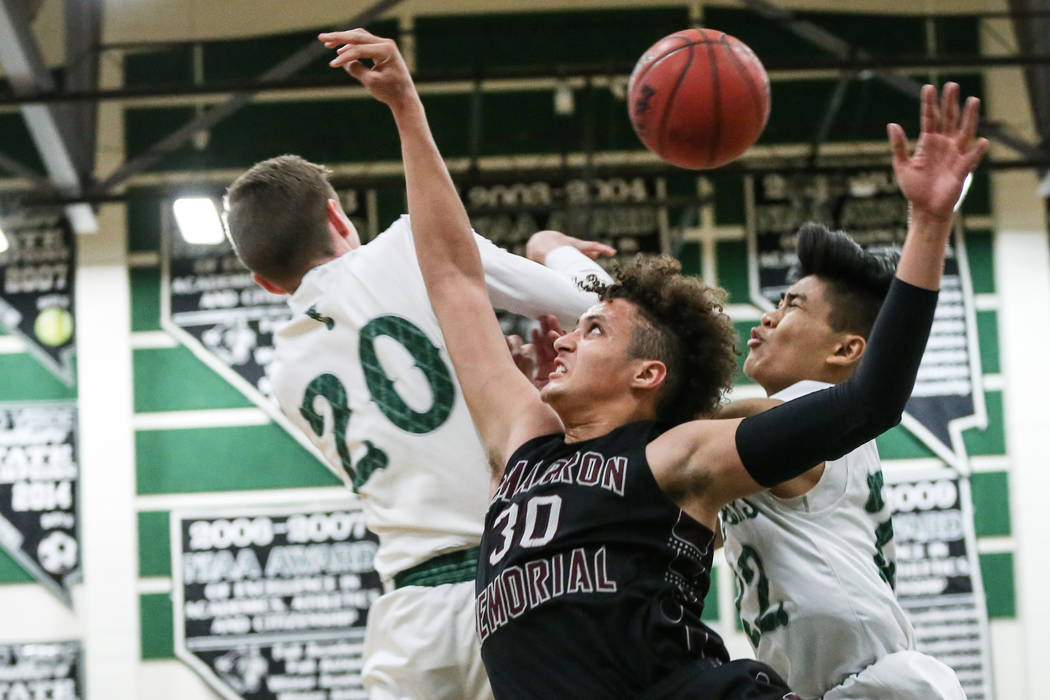 Palo Verde's Dane Clawson (20), left, Cimarron-Memorial's George Tribble Jr. (30), center, and Palo Verde's Dylan Yoro (22), right, jump for the ball during the third quarter  ...