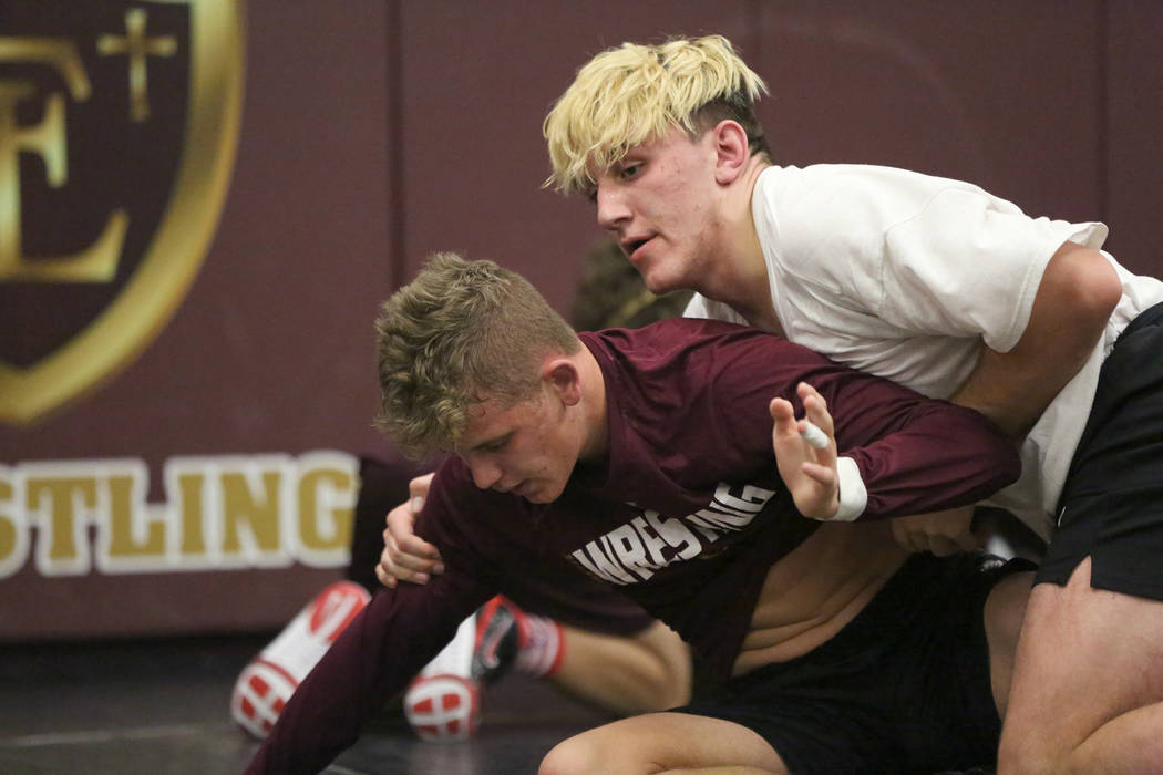 Faith Lutheran High School wrestler Connor Bourne, right, practices holds with drilling partner Carson Cook on Tuesday, Dec. 12, 2017. Michael Quine/Las Vegas Review-Journal @Vegas88s